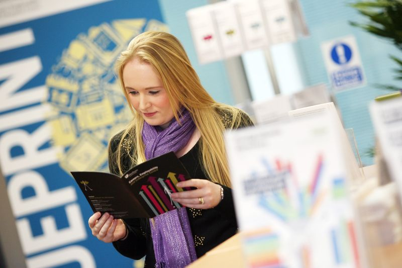 Student reading a career brochure