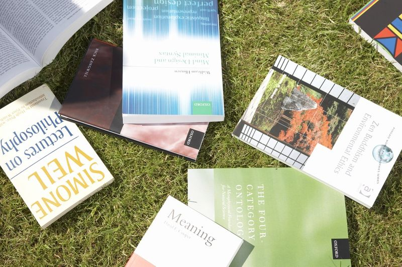 A selection of books that have been scattered on the ground