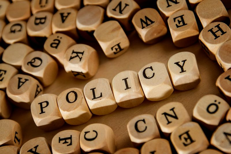 The word Policy written in lettered cubes