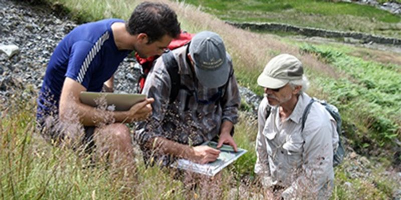 Three people doing field research