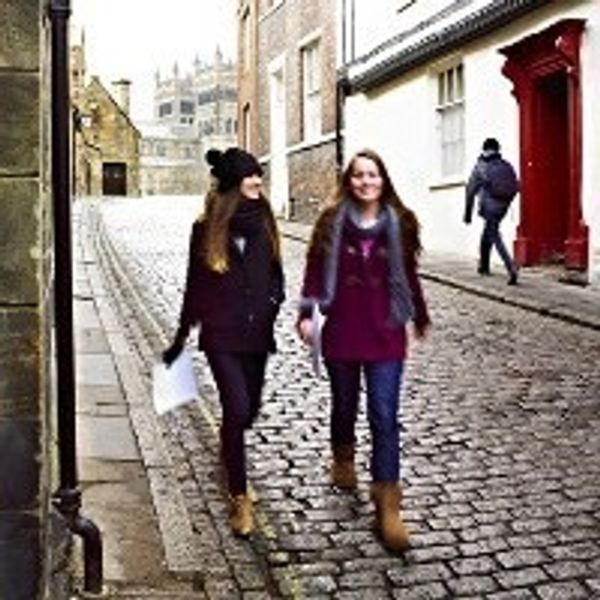 Two students walking down Durham street