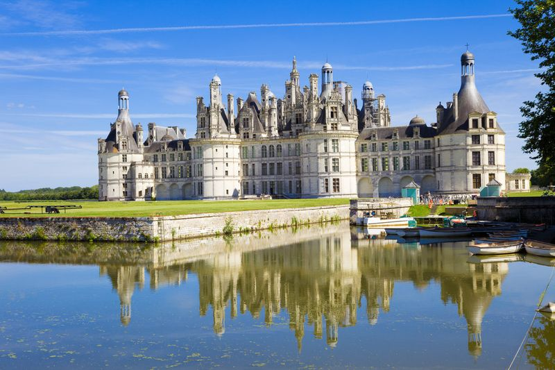 French chateau with canal reflection
