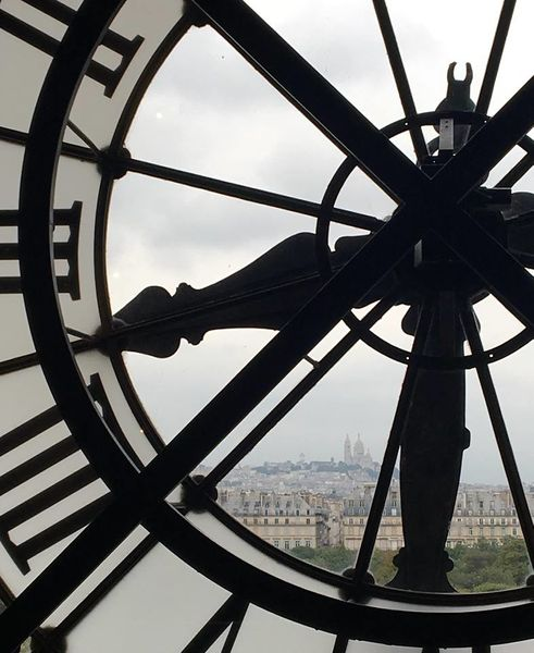 A view over Paris through a clock face