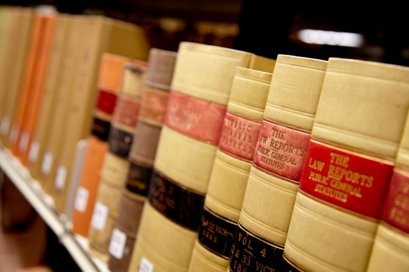 Close-up of law books on shelf