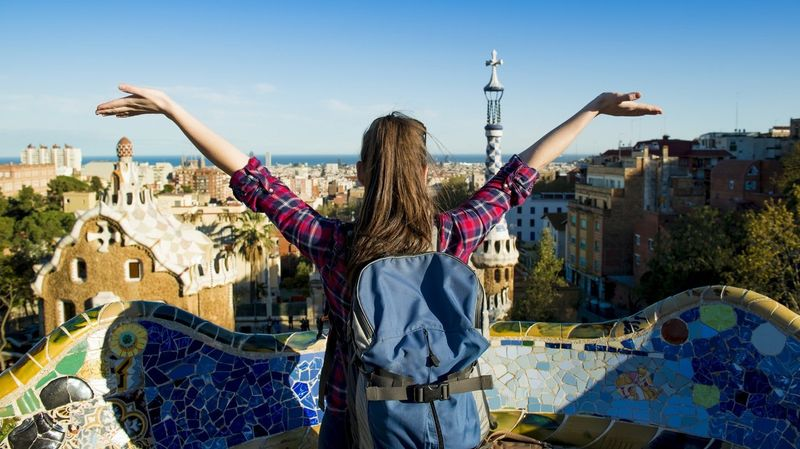 Backpacking student soaking up a view of Barcelona