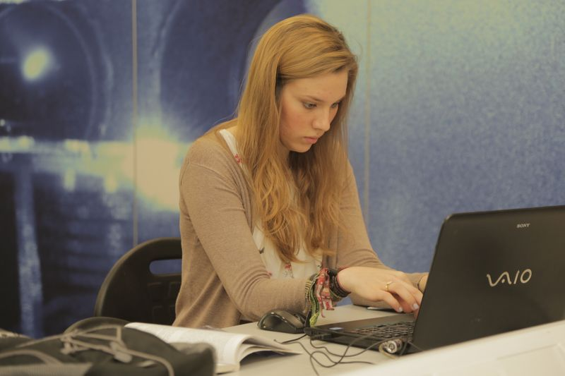 Female undergraduate student on laptop