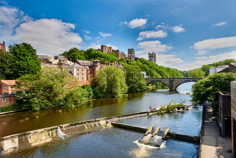 View of Durham Castle, Durham Cathedral and Framwellgate Bridge across the river