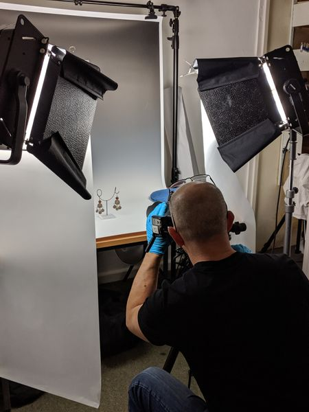 Photographer taking an exhibit photo in a studio