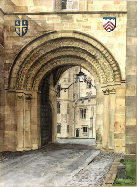 An archway in a stone building leading into a courtyard
