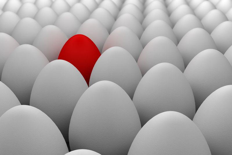 A red egg amongst white eggs
