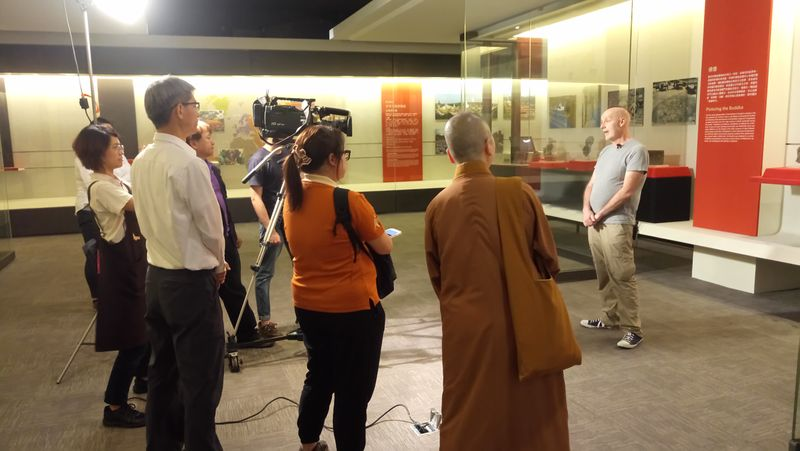 Filming a TV interview during installation of Walking with the Buddha