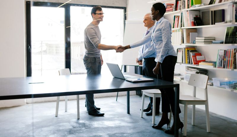 People shaking hands during a job interview