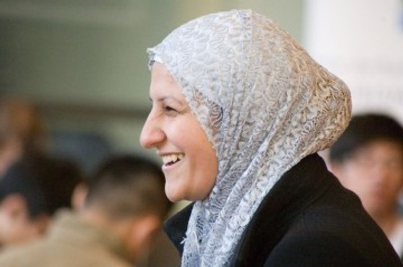 A woman in a headscarf smiling