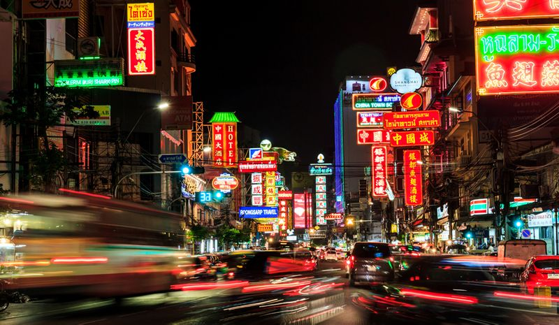 A bustling, neon-lit city in China at night