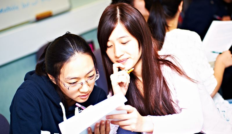 Students discussing work during a seminar
