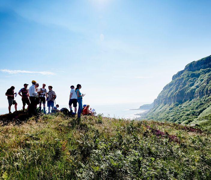 People overlooking cliffs