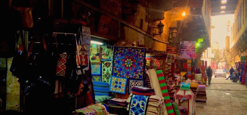 Market stall showcasing colourful textiles