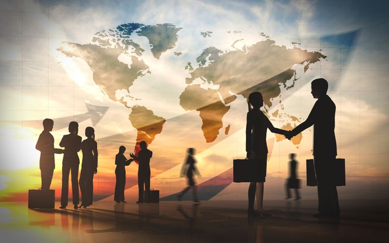 Global team business shake hand silhouettes city with world maps