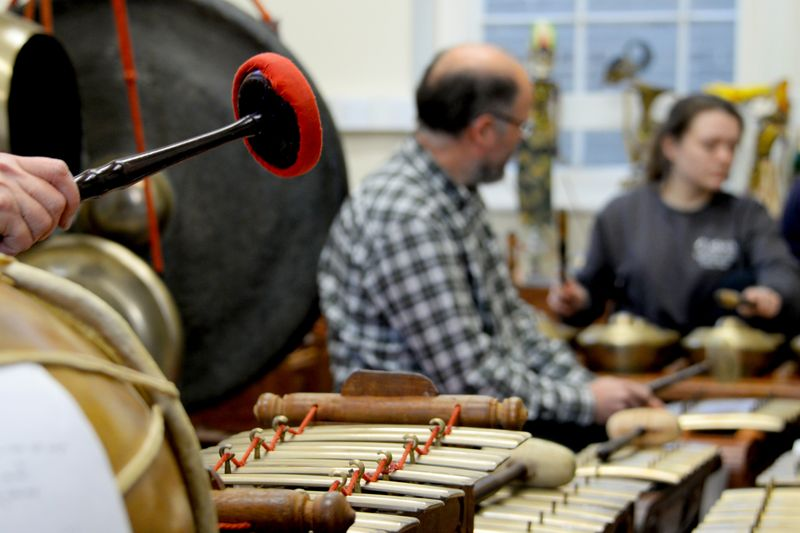 Gamelan rehearsal with tuned gongs, metallophones and drums