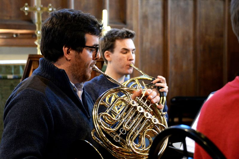 Two students playing the horn in Hatfield Chapel