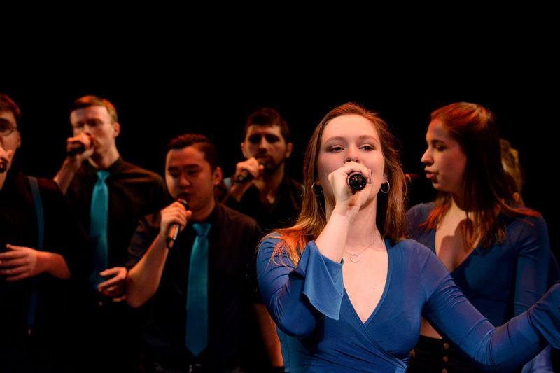 Singers performing at the Gala Theatre