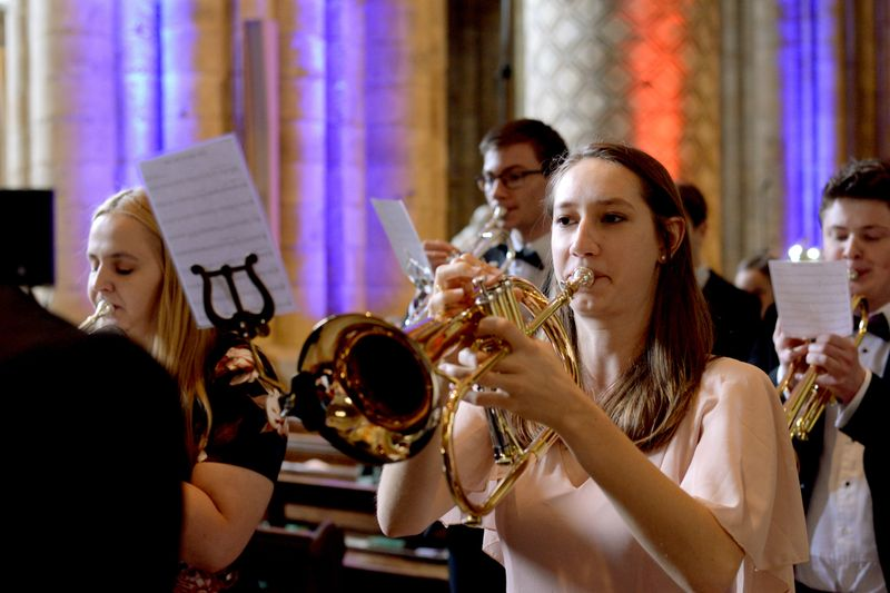 Students performing on brass instruments in the Cathedral
