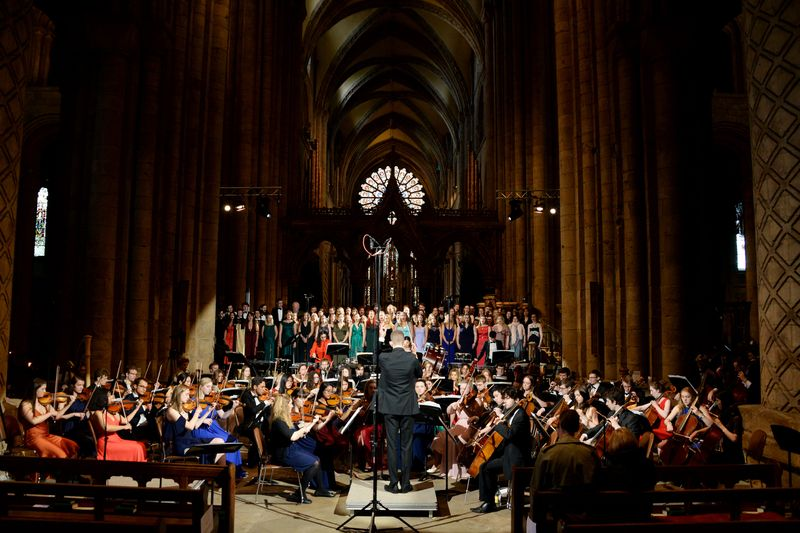 Orchestral Society and chorus performing in Durham Cathedral