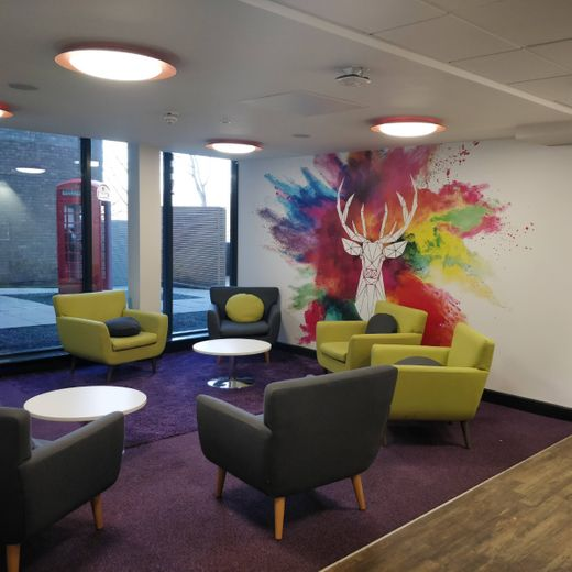 Meeting space in the JCR with stag mural