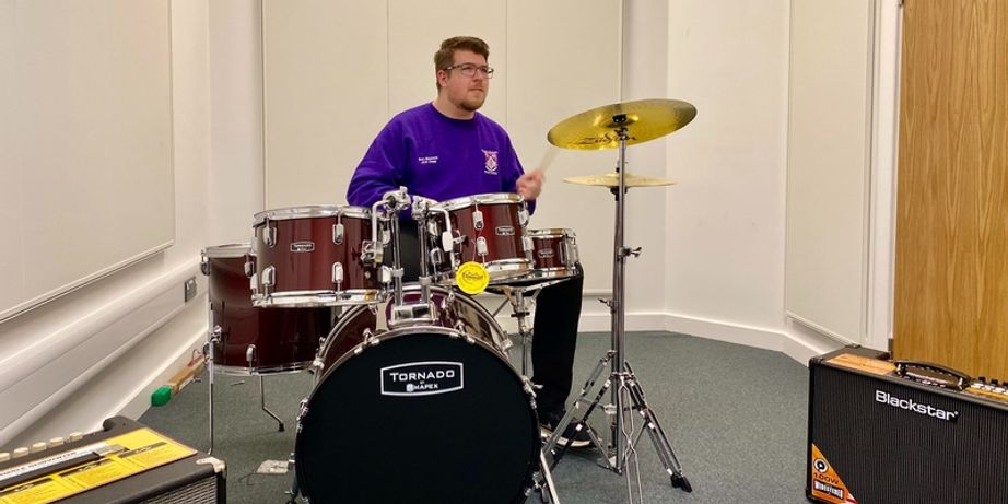 A student playing the drums