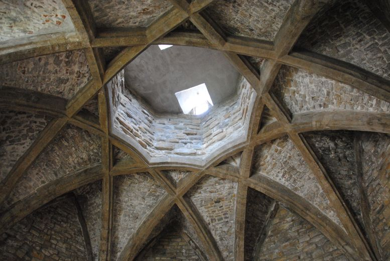 a photo of a vaulted medieval roof forming an 8-pointed star