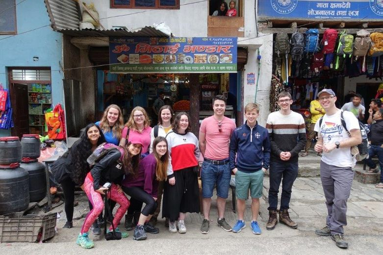 Students outside a roadside cafe in Bahrabise, Nepal, March 2019