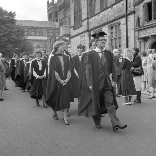 John Dewdney leads a procession towards its Graduation Congregation in the 1970s