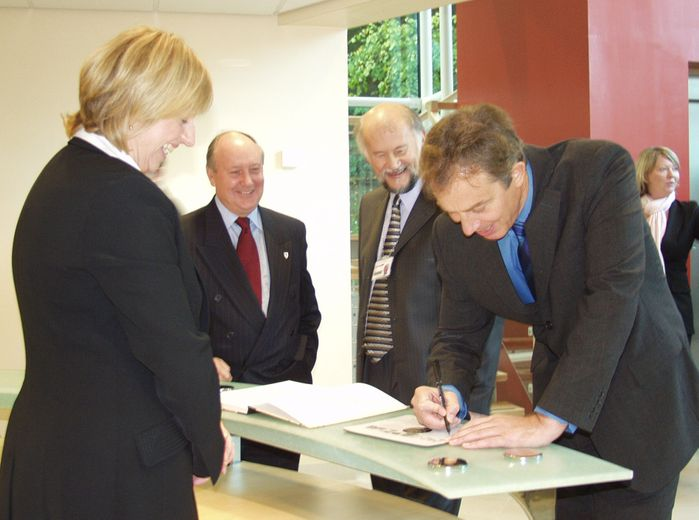 Tony Blair signs the register in the lobby of the Ogden East building