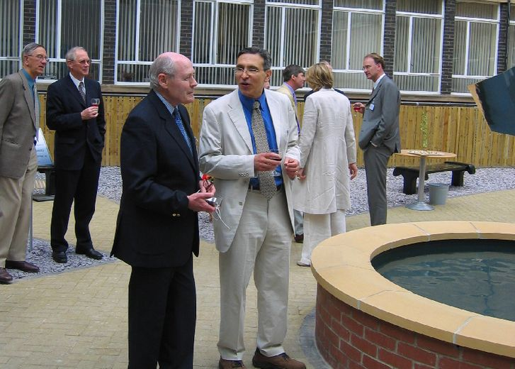Carlos Frenk with sculptor John Robinson