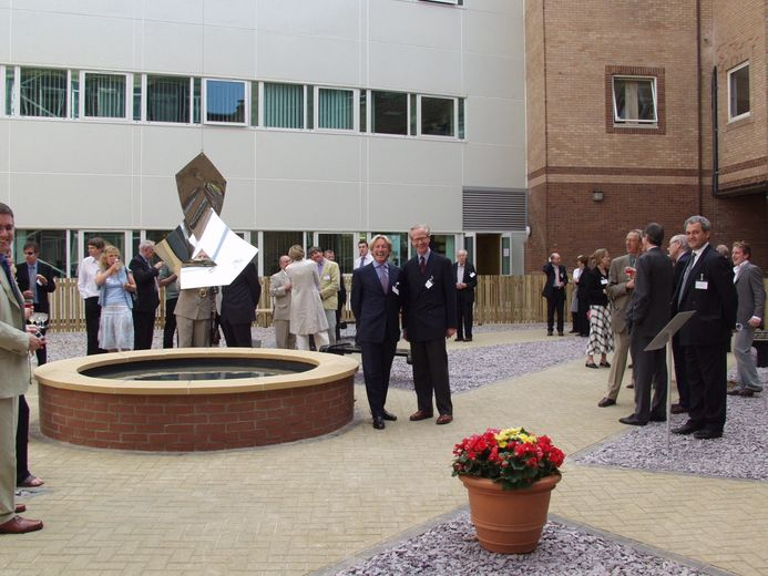 Gathering of people for the sculpture unveiling