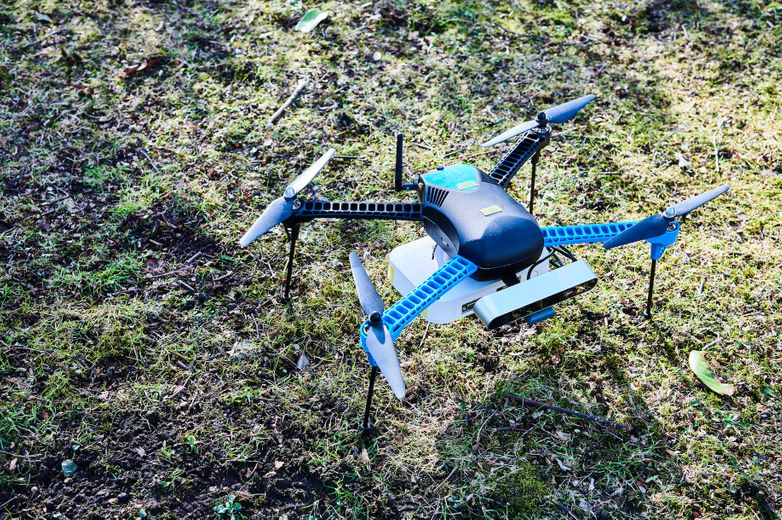 Image of a drone sitting on grass