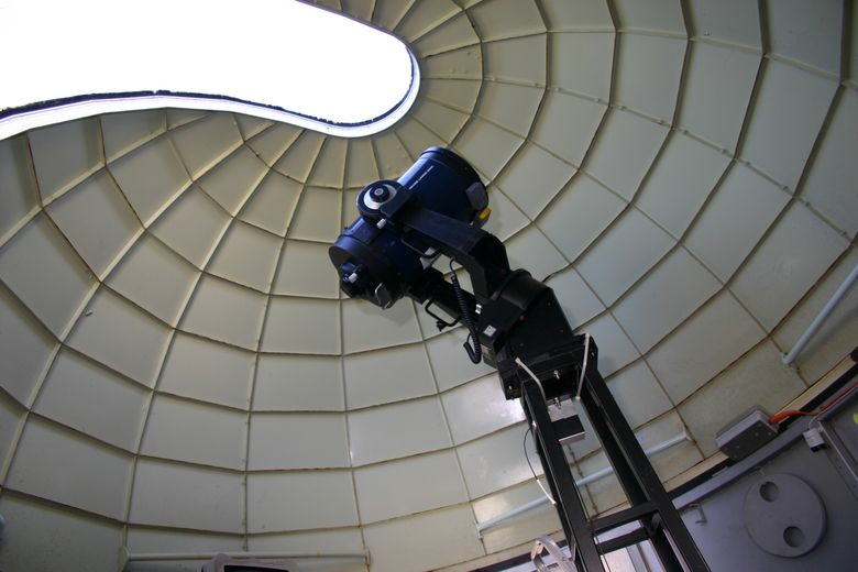 The dome begins to open above one of the department telescopes