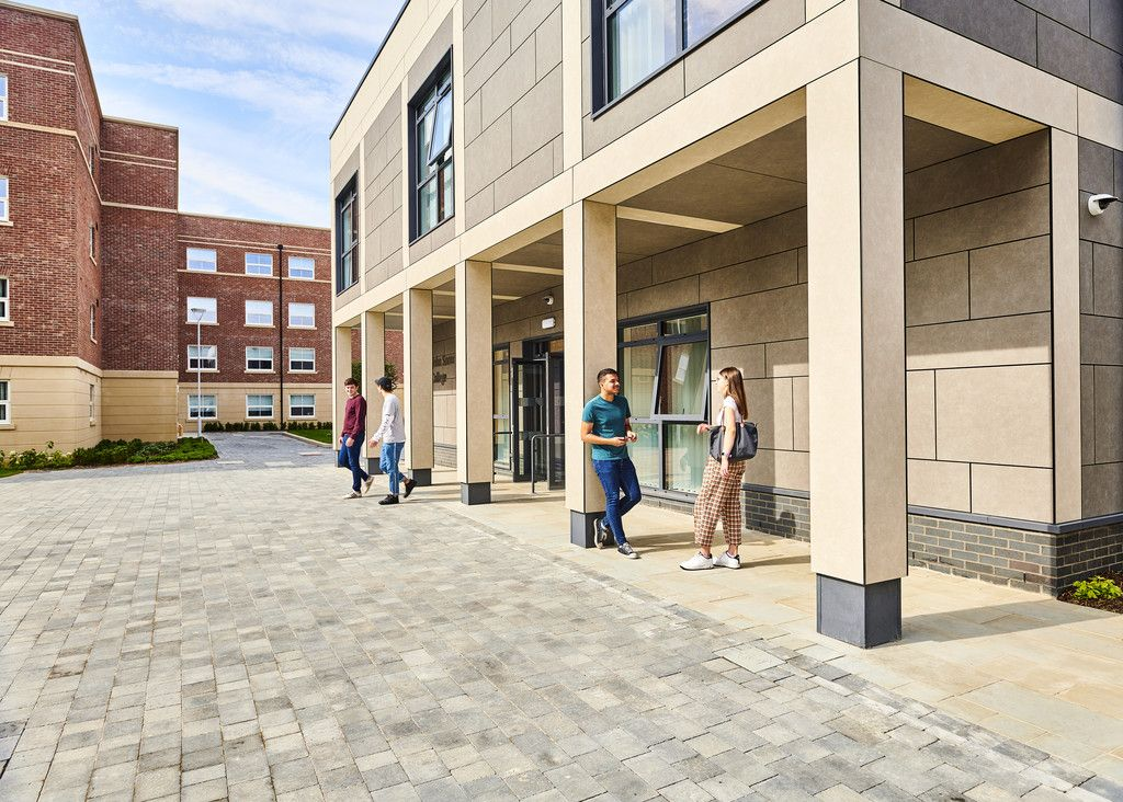 External shot of John Snow College with students