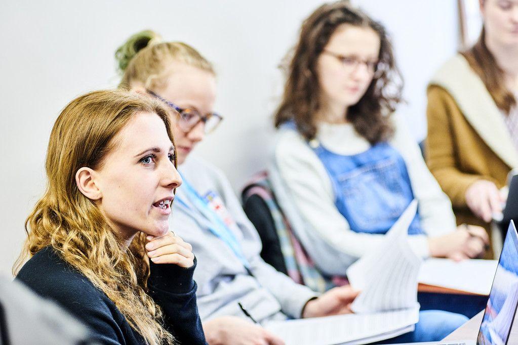 Three women attending a seminar