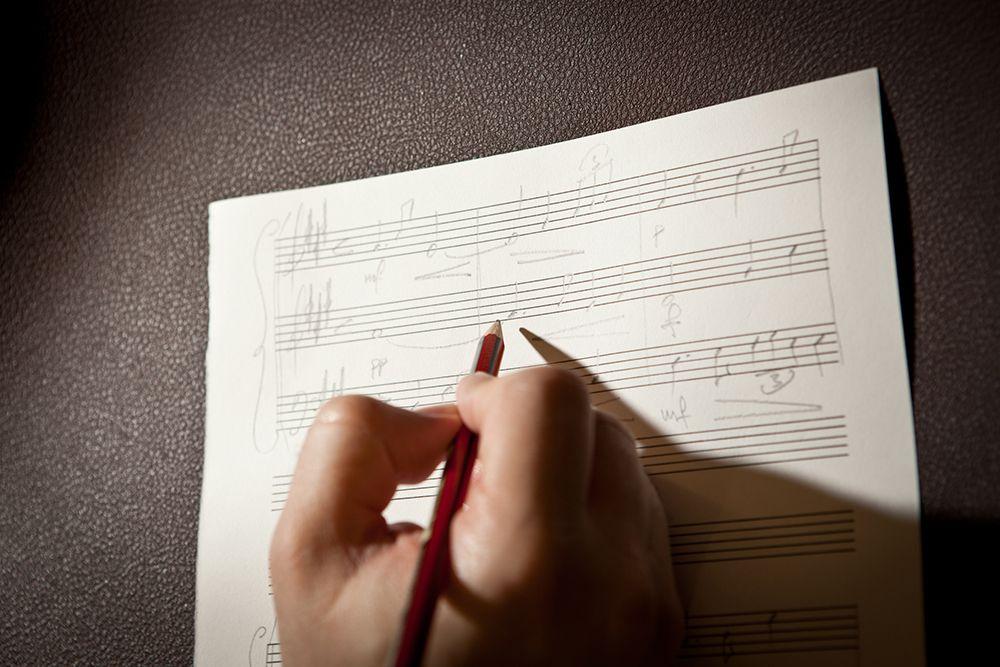 Someone writing sheet music
