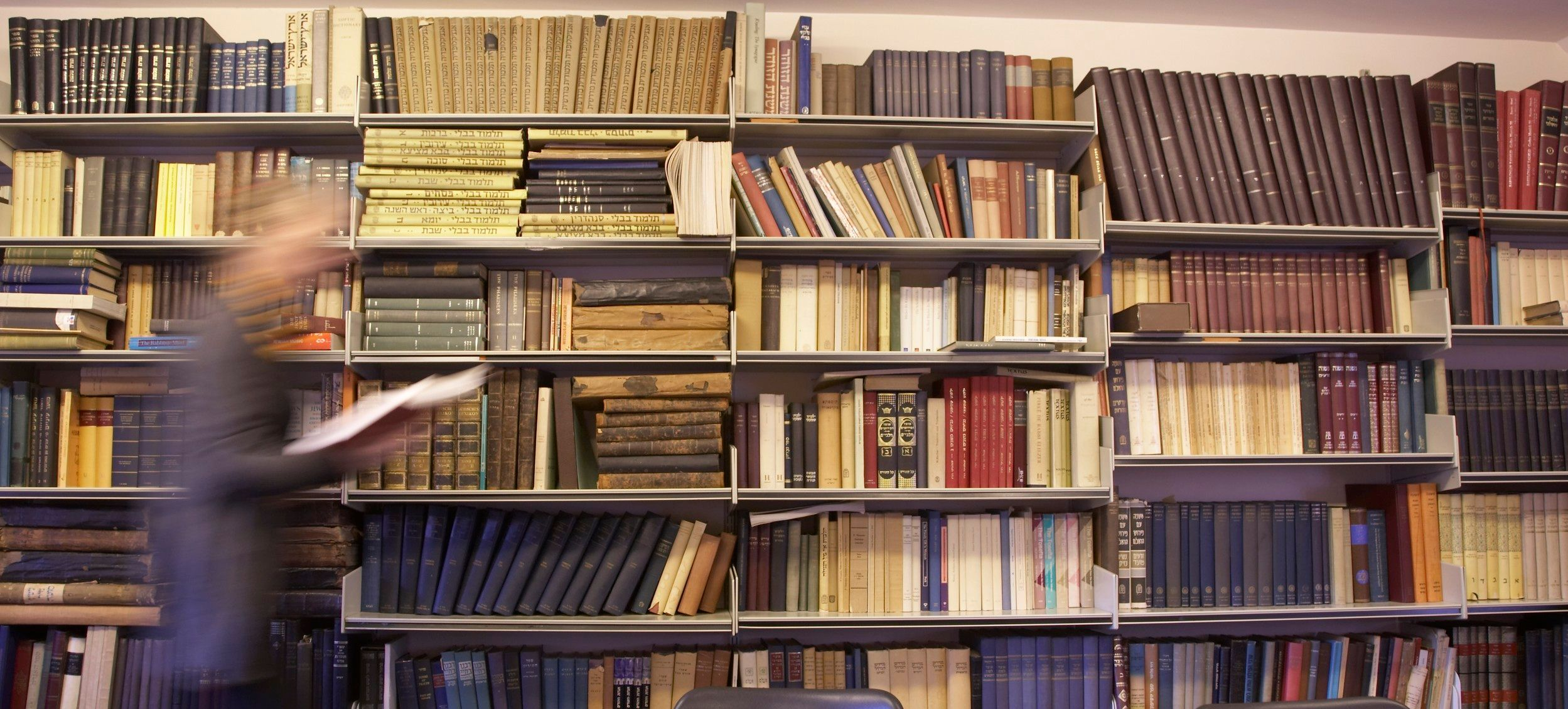 Shelves of books from theology and religion