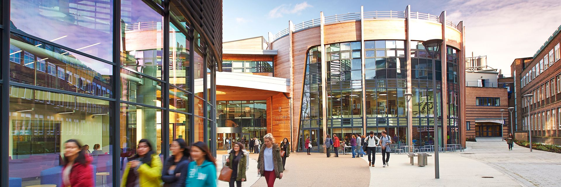 The exterior of the Palatine Centre, bustling with students between lessons