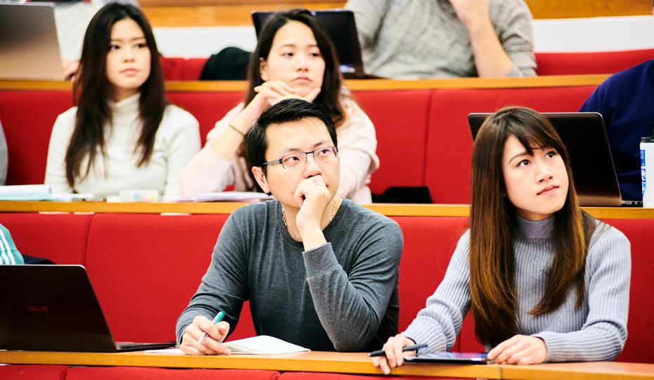 Students listening intently during a seminar